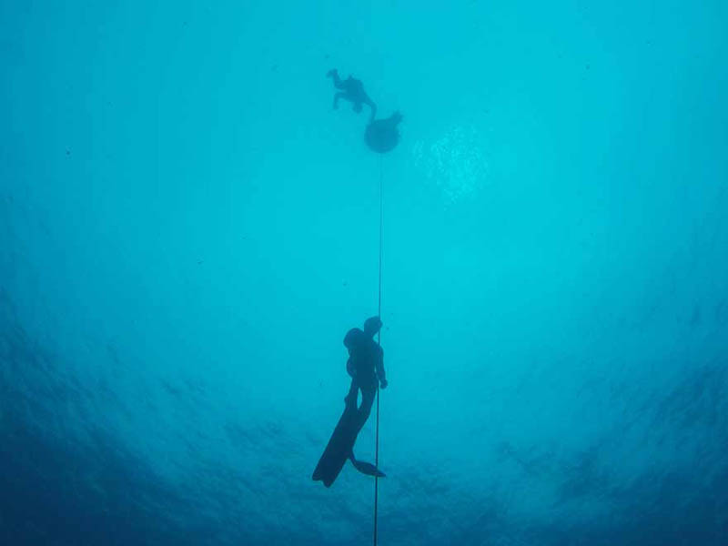 A freediver in Moalboal, Cebu, Philippines doing deep dive training