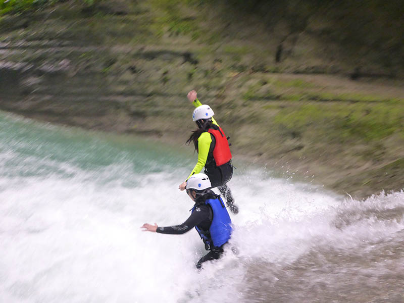 Friends jumping in Kawasan/Alegria Canyoning